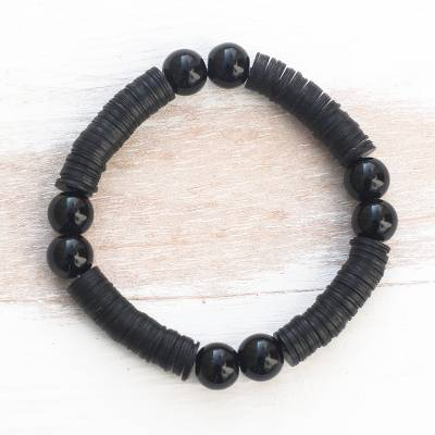 Recycled plastic beaded stretch bracelet, 'Tutum Yefe' - Black Recycled Plastic Beaded Stretch Bracelet from Ghana