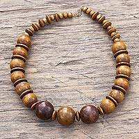 Wood beaded necklace, 'Promise of Beauty' - Sese Wood Necklace with Beads and Discs from Ghana