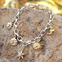 Gold plated charm bracelet, 'Moon and Sun' - Gold plated charm bracelet