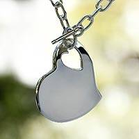 Sterling silver heart necklace, 'Your Heart in Mine' - Heart Shaped Sterling Silver Pendant Necklace