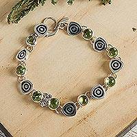 Peridot charm bracelet, 'Hypnotize' (Mexico)