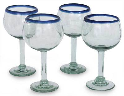 Blown glass wine glasses, 'Sapphire Globe' (set of 4) - Handblown Recycled Glass Blue and Clear Wine Glasses For 4