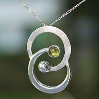 Peridot pendant necklace, 'Gemini, the Twins' - Zodiac Sterling Silver Peridot Necklace