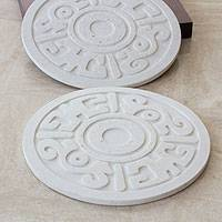Resin hot pads, 'Ancient Flower' (Pair) - Trivets Handcrafted of Resin with Pre-Hispanic Embossed Desi