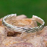 Sterling silver cuff bracelet, 'Lassos' - Mexican Sterling Silver Handmade Polished Cuff Bracelet