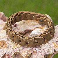 Braided leather bracelet, 'Hooked on Honey' - Distressed Golden Brown Braided Leather Bracelet