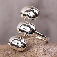 Sterling silver wrap ring, 'Three Seeds of Life' - Mexican Sterling Silver Modern Wrap Ring