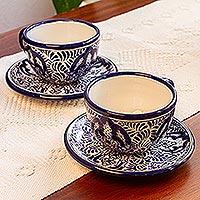 Ceramic cup and saucer set, 'Puebla Kaleidoscope' - Majolica Ceramic Blue Floral Cup and Saucer
