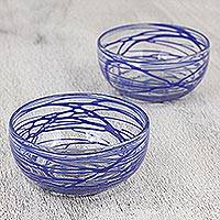 Blown glass bowls, 'Sapphire Swirl' (pair) - Two Clear Blown Glass Bowls with Blue Swirls from Mexico