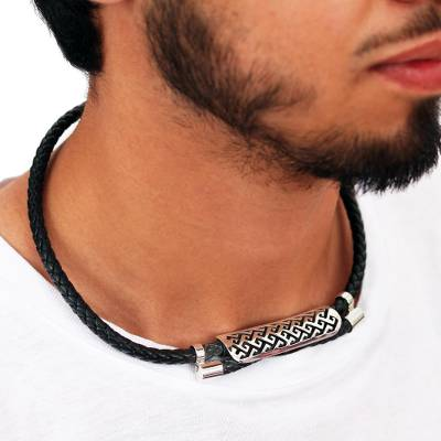 Sterling silver and leather pendant necklace, 'Celtic Frieze' - Leather and Sterling Silver Pendant Necklace from Mexico