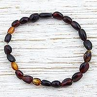 Amber beaded stretch bracelet, 'Ancient Obscurity' - Hand Made Natural Amber Beaded Stretch Bracelet Mexico