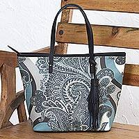 Leather accented coated canvas tote handbag,