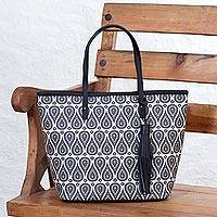 Leather accented coated canvas tote bag,