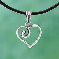 Sterling silver and leather pendant necklace, 'Spiraling Heart' - Sterling Silver Heart Pendant Leather Necklace from Mexico