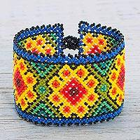 Beaded wristband bracelet, 'Huichol Cactus Flowers' - Glass Beaded Wristband Bracelet with Huichol Floral Motifs