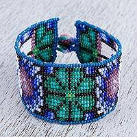 Glass beaded wristband bracelet, 'The Connection' - Glass Beaded Bracelet with Floral Motifs from Mexico