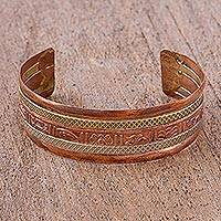 Copper and brass cuff bracelet, 'Ciphered in Glyphs' - Copper Aztec Theme Cuff Bracelet with Brass and Aluminum