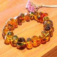 Amber beaded stretch bracelet, 'Honey Stones' - Hand Crafted Amber Bead Stretch Bracelet from Mexico