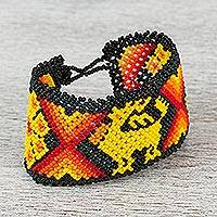 Glass beaded wristband bracelet, 'The Journey's Guide' - Mexican Artisan Crafted Huichol Motif Beaded Bracelet