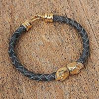 Gold-plated leather braided pendant bracelet, 'Mexican Skulls in Blue' - Blue Braided Leather 18k Gold-plated Skull Pendant Bracelet