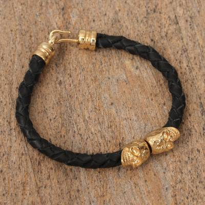 Gold-plated leather braided pendant bracelet, 'Mexican Skulls in Black' - Mexican Black Leather Gold-plated Skull Pendant Bracelet