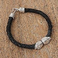 Braided leather pendant bracelet, 'Death in Black' - Mexican Black Hand Braided Leather Skull Pendant Bracelet