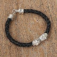 Braided leather pendant bracelet, 'Death is in Style' - Black Handmade Leather Bracelet with Sterling Silver Skulls