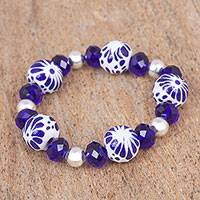Ceramic beaded stretch bracelet, 'Indigo Twilight' - Ceramic Puebla Bead, Blue and Silver Stretch Bracelet