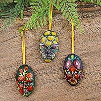 Ceramic ornaments, 'Floral Faces' (set of 3) - 3 Signed Handcrafted Floral Ceramic Mask Ornaments