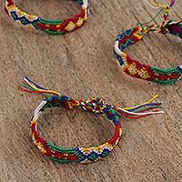 Cotton braided wristband bracelets, 'Colorful Rain' (set of 3) - Multicolored Braided Cotton Bracelets (3) from Mexico
