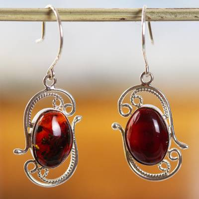 Amber drop earrings, 'Unearthed Treasure' - Handcrafted Oval Dark Amber Sterling Silver Drop Earrings