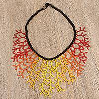 Glass beaded statement necklace, 'Fiery Huichol Roots' - Red and Yellow Glass Beaded Statement Necklace from Mexico