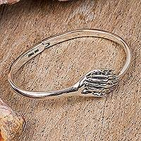 Sterling silver bangle bracelet, 'Joining Hands' - Sterling Silver Bangle Bracelet from Mexico