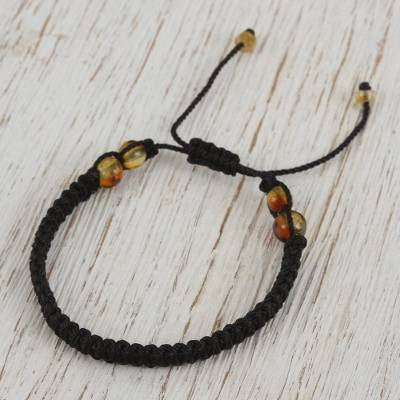 Amber beaded macrame bracelet, 'Age-Old Passion in Black' - Amber Beaded Macrame Bracelet in Black from Mexico