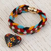 Wood braided wristband bracelet, 'Floral Heart Garden' - Floral Heart Wood Braided Wristband Bracelet from Mexico