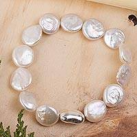 Cultured pearl beaded stretch bracelet, 'Luminous Treasures' - Handcrafted Cultured Pink-Toned Keshi Pearl Stretch Bracelet