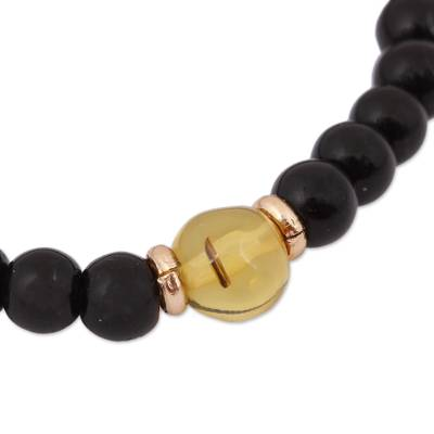 Gold accented amber and onyx beaded stretch bracelet, 'Ancient Depth' - Amber and Onyx Beaded Stretch Bracelet with 14k Gold Accents