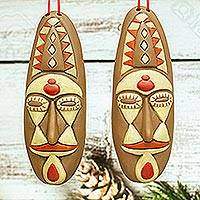 Ceramic ornaments, 'Stunning Masks' (pair) - Brown and Beige Ceramic Mask Ornaments from Mexico (Pair)
