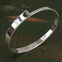 Sterling silver bangle bracelet, 'Lovely Gleam' - Taxco Sterling Silver Bangle Bracelet from Mexico