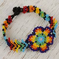 Glass beaded wristband bracelet, 'Colorful Huichol Flower' - Floral Glass Beaded Wristband Necklace from Mexico