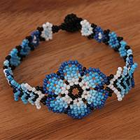 Glass beaded wristband bracelet, 'Blue-Spined Flower' - Floral Glass Beaded Wristband Bracelet in Blue from Mexico