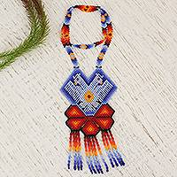 Glass beaded pendant necklace, 'Two Eagles in Blue' - Eagle-Themed Glass Beaded Pendant Necklace from Mexico