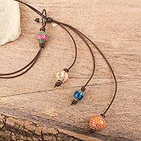 Wood and leather lariat necklace, 'Painted Orbs' - Artisan Crafted Copal Wood and Leather Lariat Necklace