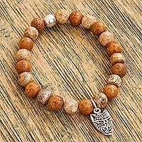 Agate beaded stretch bracelet, 'Stylized Wolf in Brown' - Brown Agate Beaded Stretch Bracelet with Wolf Charm