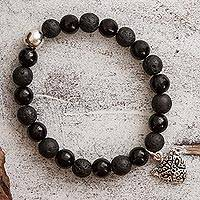 Onyx beaded stretch bracelet, 'Dark Stylized Jaguar' - Onyx and Lava Stone Stretch Bracelet with a Jaguar Charm
