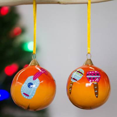Ceramic ornaments, 'Skeleton Song' (pair) - Two Handcrafted Mexico Theme Ceramic Ornaments in Orange