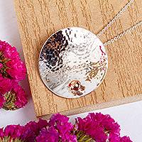 Sterling silver pendant necklace, 'Hammered Sun' - Taxco Abstract Sterling Silver and Copper Pendant Necklace