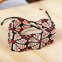 Beaded wristband bracelet, 'Peyote Flower in Coral' - Huichol Style Beaded Floral Bracelet from Mexico