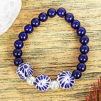 Lapis lazuli and ceramic stretch bracelet, 'Indigo Garden' - Lapis Lazuli Bracelet with Ceramic Pendant
