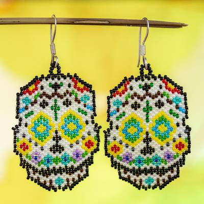 Glass beaded dangle earrings, 'Blue-Eyed Skeleton' - Huichol Beadwork Day of the Dead Blue-Eyed Skull Earrings
